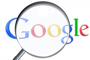 Magnifying glass over google logo