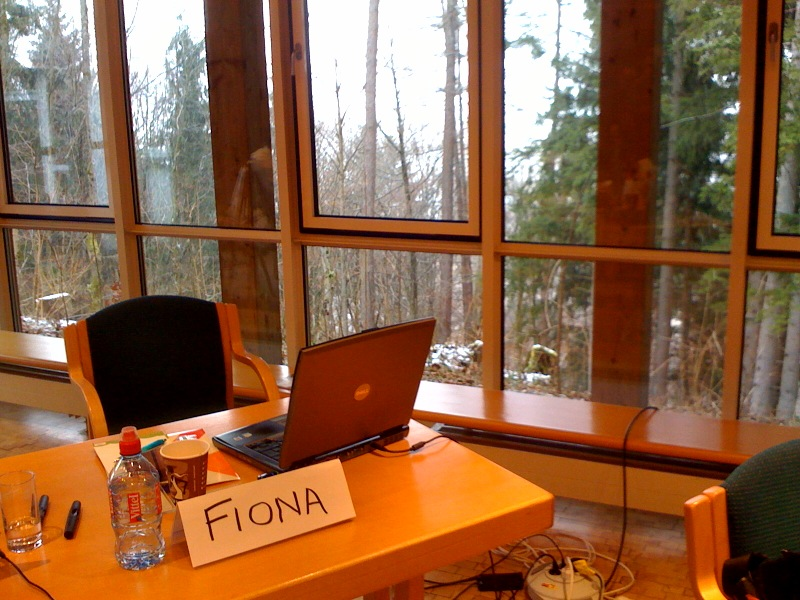 Workstation at Kochel am See, Germany with snowy view through window
